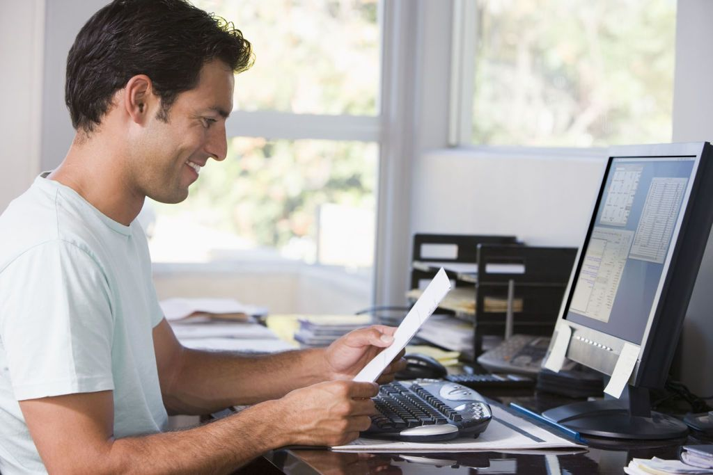man in front of his computer